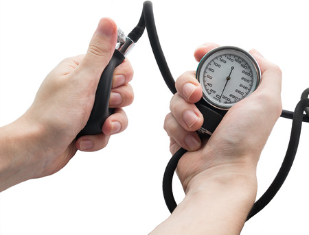 Blood pressure gauge in the hands  Isolated on white Stock Photo - 25442050