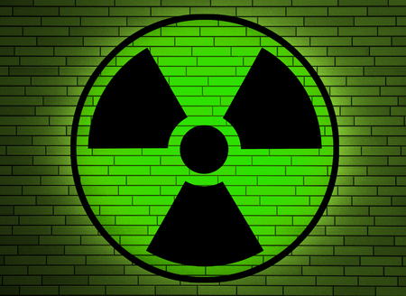 Radiation sign on a brick wall Stock Photo - 25638830