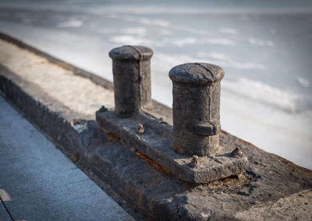 Old and rusty ships mooring bollard photo