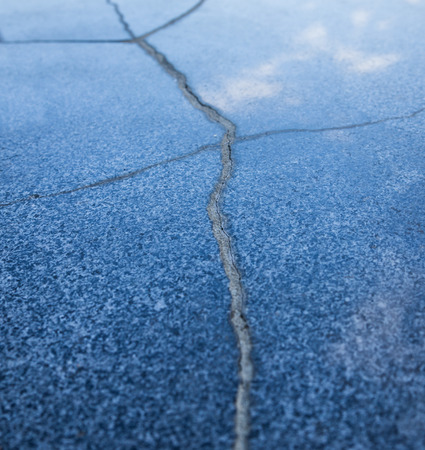 polished granite:    Polished granite with cracks  Selective focus with shallow depth of field