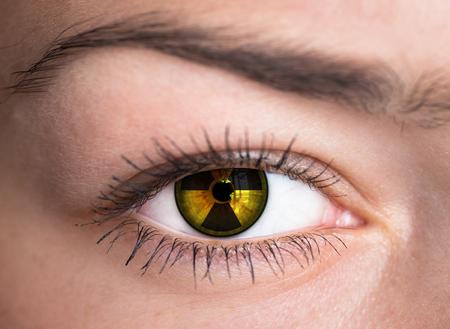 Human eye with radiation hazard symbol  Stock Photo