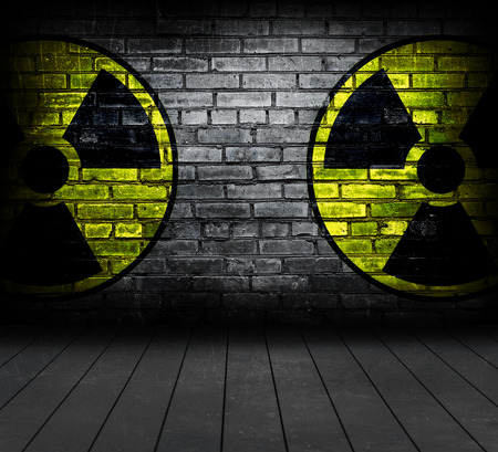 Two radiation sign on a brick wall  photo