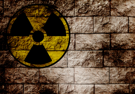 Radiation sign on a brick wall   photo