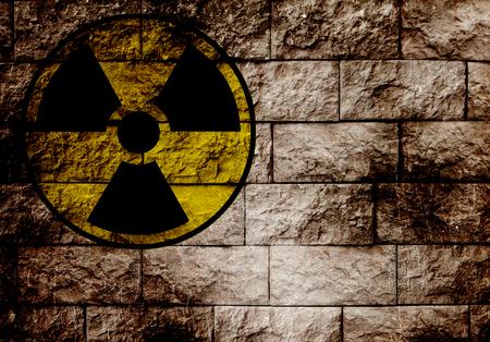 Radiation sign on a brick wall   photo