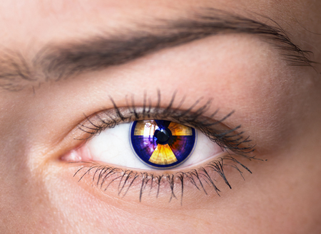 radioisotope:  Human eye with radiation hazard symbol - concept photo   Stock Photo