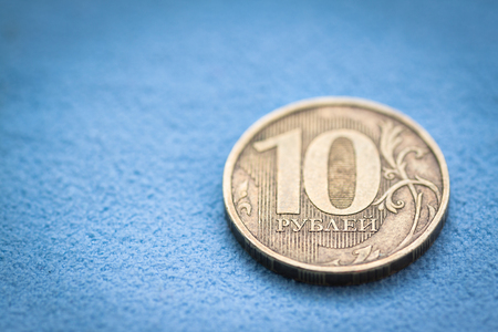 opulence:    Russian coin - ten rubles, macro shot with selective focus and shallow depth of field