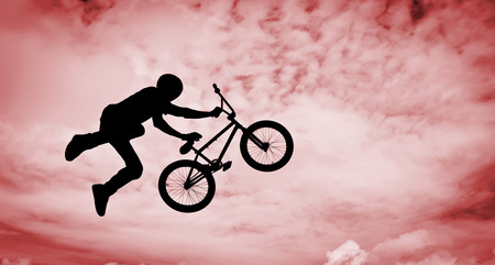 Silhouette of a man doing an jump with a bmx bike  Stock Photo