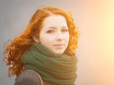 Beautiful redhead girl in the sunshine  photo