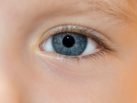 Child s blue eye - macro  Selective focus with shallow depth of field  photo