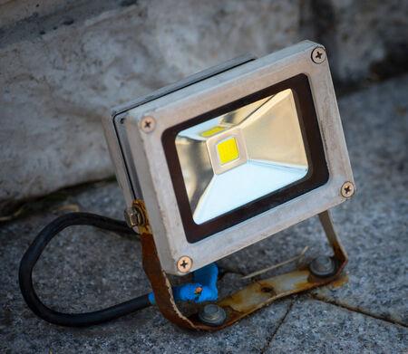 Rusty and dirty LED spotlight photo