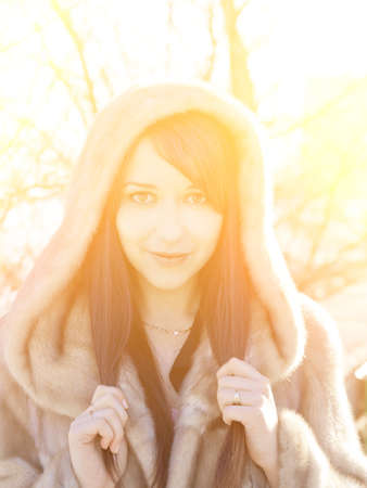 Winter girl with strong sunshine effect  Color toned image  Stock Photo