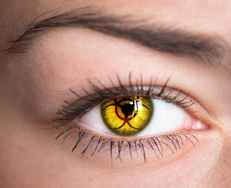 radioisotope:   Human eye with biohazard symbol - concept photo