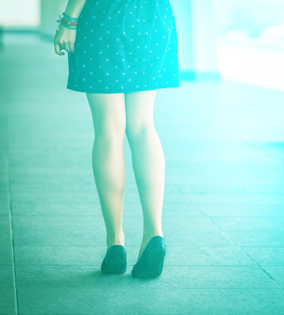 Beautiful, women s legs in shoes  With sunshine effect   photo