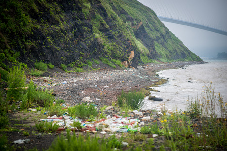 Plastic bottles and other garbage on the shore of the Sea of Japan near Vladivostok  photo