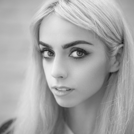 Black and white portrait of a beautiful blonde girl close-up. photo