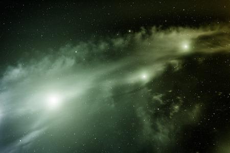 Space with nebula and three bright stars. Stock Photo