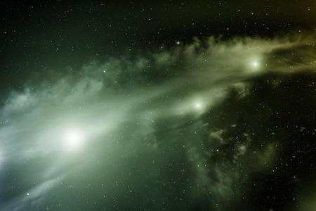 looming: Space with nebula and three bright stars. Stock Photo