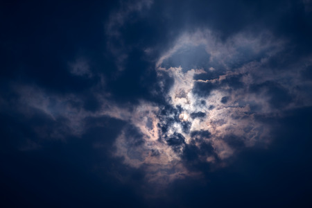 hdri: Dramatic sky with heavy clouds and sun. Color toned image. Stock Photo