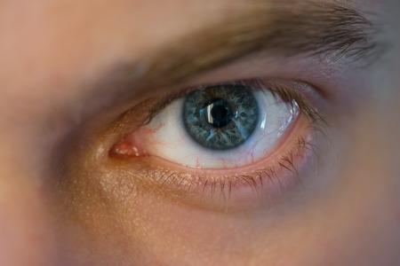 image style: Blue man eye, macro shot. Shallow depth of field.