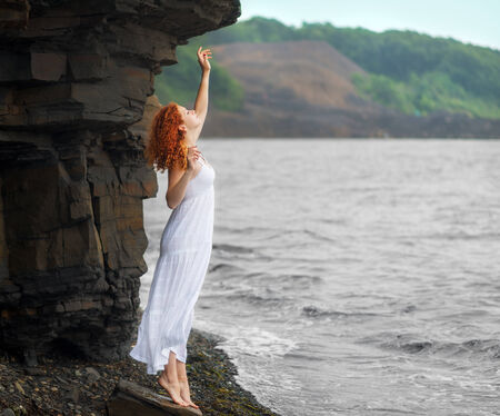 Redhead Woman In White Dress Standing On Beach And Looking To ...