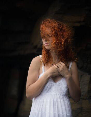 beautiful redhead: Beautiful redhead woman in a white dress, outdoor. Stock Photo