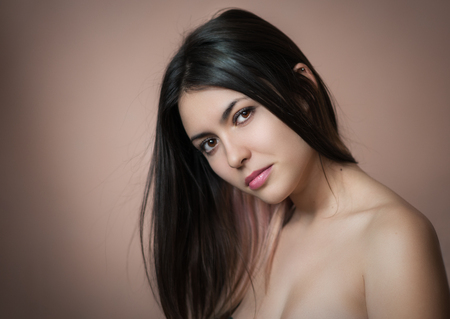 Portrait of a beautiful young brunette. Selective soft focus. photo