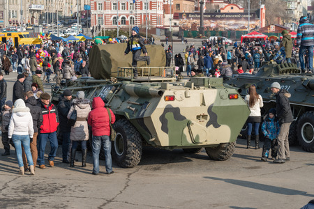festivities: VLADIVOSTOK, RUSSIA - FEBRUARY 23, 2015: Modern russian armored vehicles during festivities devoted to Defender of the Fatherland Day.