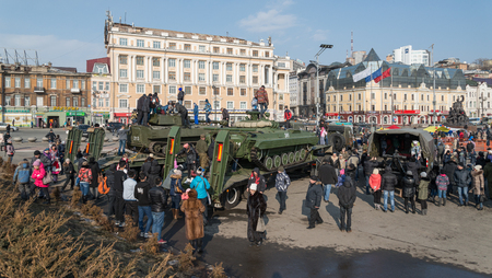 defender: VLADIVOSTOK, RUSSIA - FEBRUARY 23, 2015: Modern russian armored vehicles during festivities devoted to Defender of the Fatherland Day.