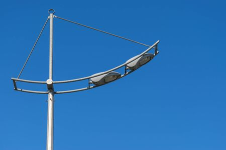 electric avenue: Street light on a blue sky background. Stock Photo
