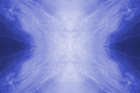resembling: Blue ink forming patterns resembling Rorschach Test ink blots.