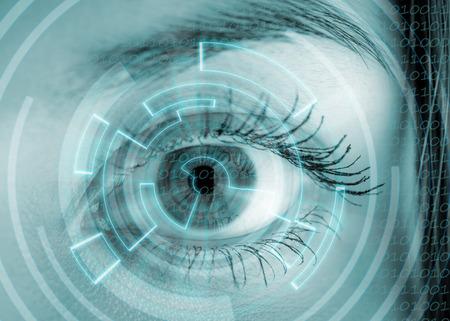 laser focus: Eye viewing digital information. Conceptual image.