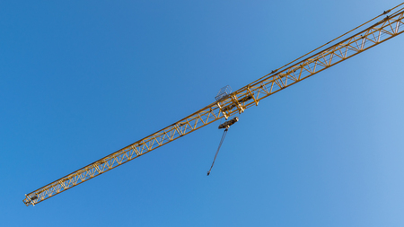 hight tech: Tower crane on blue sky background.