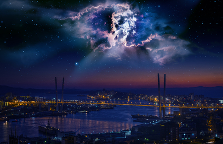 concept magical universe: City landscape at night with sky with stars and nebula.