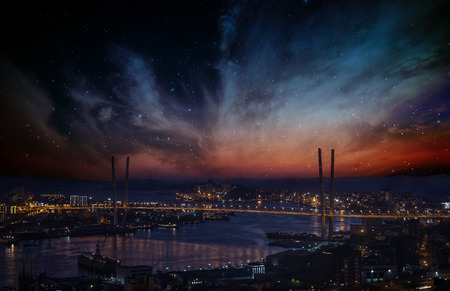 City landscape at night with sky with stars and nebula.