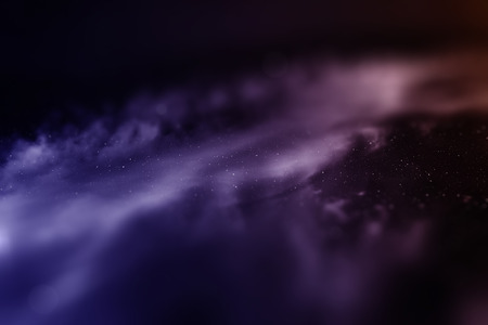 miniature: Space with nebula and bright stars with tilt-shift miniature effect. Stock Photo