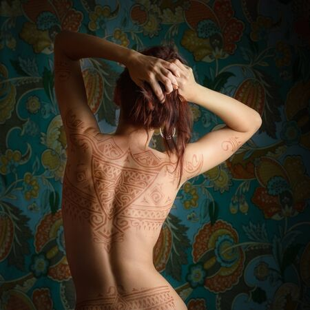 temporary: Beautiful woman with tattoo on her back.