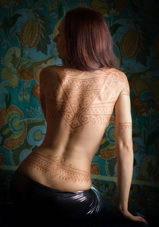 mendi: Beautiful woman with tattoo on her back.