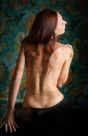 woman back: Beautiful woman with tattoo on her back.