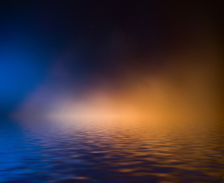 Night sky with colorful cloud and stars reflected in water.