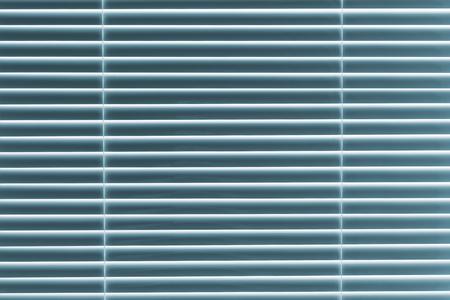 blue  toned: Venetian blinds. Blue toned.