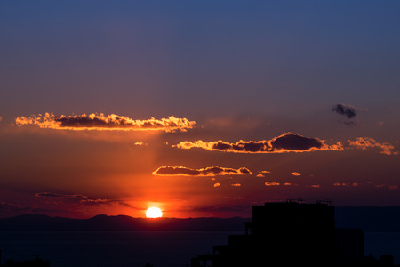 city of sunrise: Sunset and silhouette of buildings.