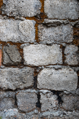 porous brick: Stone masonry wall of stone blocks. Stock Photo