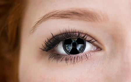 human eye: Human eye with radiation hazard symbol - concept photo. Stock Photo