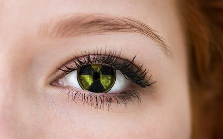 radioisotope: Human eye with radiation hazard symbol - concept photo. Stock Photo