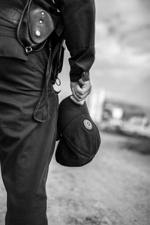 carabineer: Detail of a police officer. Selective focus with shallow depth of field. Black and white toning.