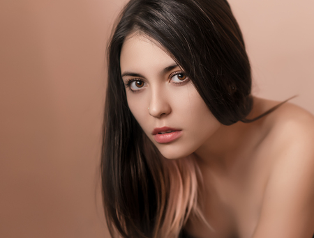 nude girl young: Portrait of a beautiful young brunette. Selective soft focus.