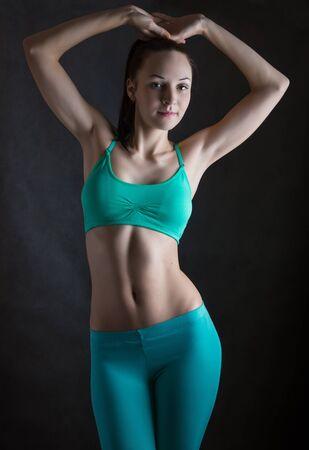 dark: Fitness woman on dark. Stock Photo