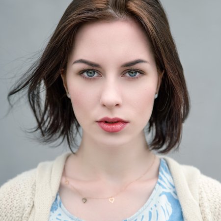 Portrait of a beautiful young woman with blue eyes.