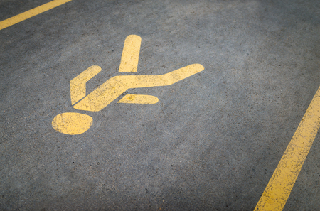 road surface: Pedestrian traffic road sign on asphalt surface.