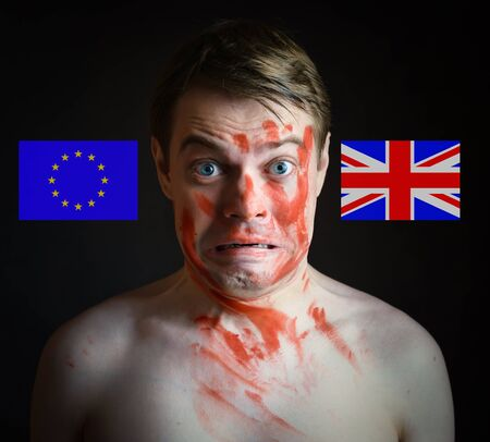 skepticism: Portrait of man who make decision with Great Britain Flag and European Union Flagon. Conceptual image.